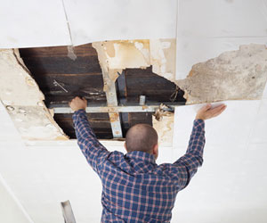 Water damaged ceiling being repaired